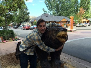 Matt hugging a big (wooden) bear