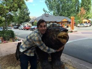 Matt hugging a big (wooden) bear